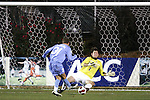 16 November 2007: Wake Forest goalkeeper Brian Edwards (1) saves a one-on-one shot from North Carolina's Brian Shriver (31). Wake Forest University played the University of North Carolinaat SAS Stadium in Cary, NC in an Atlantic Coast Conference Men's Soccer tournament semifinal.