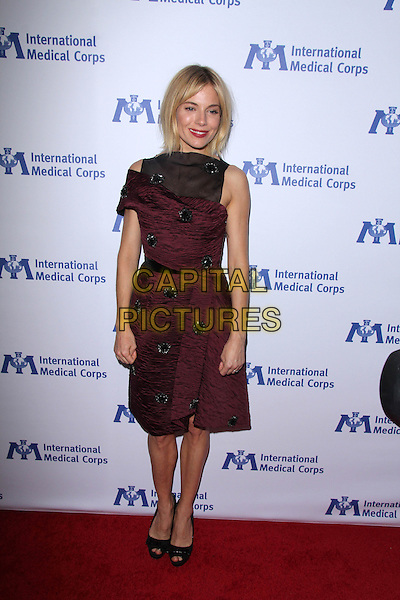 BEVERLY HILLS, CA - OCTOBER 23: Sienna Miller at the International Medical Corps 2014 Annual Awards Celebration at the  Beverly Hilton Hotel in Beverly Hills, CA on October 23, 2014.  <br /> CAP/MPI/DC/DE<br /> &copy;DE/DC/MediaPunch/Capital Pictures