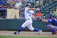 First baseman Cheslor Cuthbert #24  of the Omaha Storm Chasers swings against the Las Vegas 51s at Werner Park on August 17, 2014 in Omaha, Nebraska. The Storm Chasers  won 4-0.   (Dennis Hubbard/Four Seam Images)