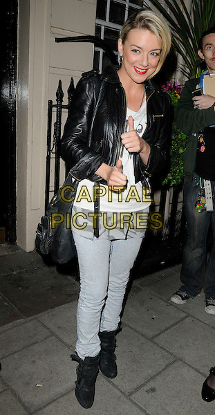"SHERIDAN SMITH .Seen leaving after the evening performance of ""Flare Path"", Theatre Royal Haymarket, London, England, UK, April 12th 2011..full length jeans black leather jacket ankle boots thumb up white top gesture .CAP/CAN.©Can Nguyen/Capital Pictures."
