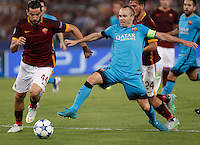 Calcio, Champions League, Gruppo E: Roma vs Barcellona. Roma, stadio Olimpico, 16 settembre 2015.<br /> FC Barcelona&rsquo;s Andres Iniesta, right, is challenged by Roma&rsquo;s Kostas Manolas, during a Champions League, Group E football match between Roma and FC Barcelona, at Rome's Olympic stadium, 16 September 2015.<br /> UPDATE IMAGES PRESS/Isabella Bonotto
