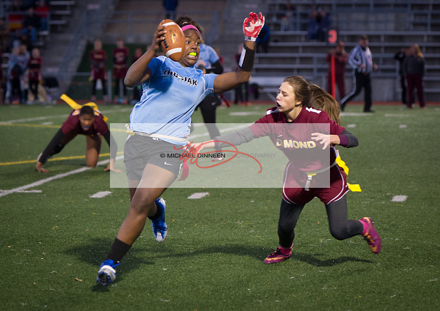 Chugiak quarterback Chastity Seden avoids the grasp of Dimond's Mariah Youngmun in their CIC Flag Football playoff game Thursday, Oct 13, 2016.  Photo for the Star by Michael Dinneen