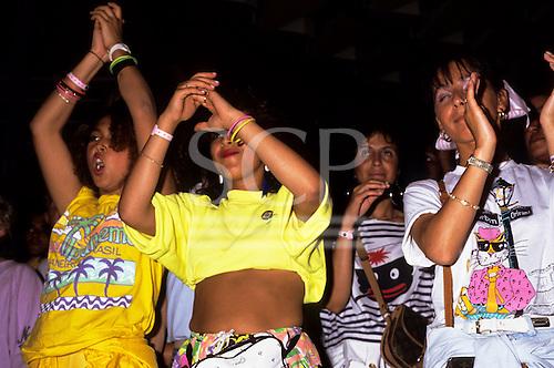Rio de Janeiro, Brazil. Group of girls clapping, one wearing an Ipanema t-shirt.