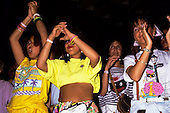 Rio de Janeiro, Brazil. Group of girls clapping, one wearing an Ipanema t-shirt.