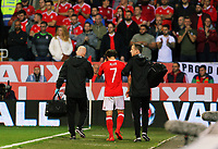 Wales physiotherapists escort Joe Allen (C) off the pitch after suffering a suspected head injury during the FIFA World Cup Qualifier Group D match between Wales and Republic of Ireland at The Cardiff City Stadium, Wales, UK. Monday 09 October 2017