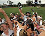 (Boston Ma 061414) Westwood goalie Meghan Raskin, is raises above her teammates celebrating their win over Longmeadow, during the 2014 MIAA Girls Division 1 championship game at Boston University,  Westwood won the game 9-7. (Jim Michaud Photo) For Saturday