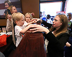 Chelsea Clinton, daughter of former President Bill Clinton and current Democratic Presidential candidate Hillary Clinton was in Metuchen at The Brown Stone to help kick off the opening of the Middlesex County Hillary for New Jersey office on Friday May 13, 2016.<br /> Here Clinton (right) stops by to visit with Jennifer White (left) and her twins Maggie and Zack, age 3 of Scotch Plains on her way out after the rally.