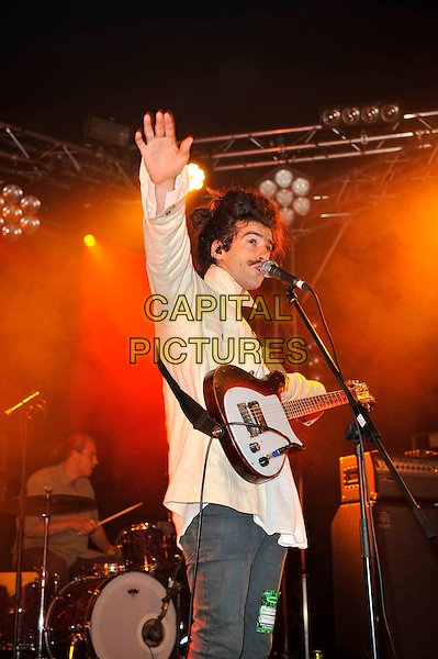 King Charles (Charles Costa).live on Day 3 at Reading Festival, Reading, England. .26th August 2012.on stage in concert live gig performance performing music half length white jacket mousatche mustache facial hair guitar singing hand arm side .CAP/MAR.© Martin Harris/Capital Pictures.