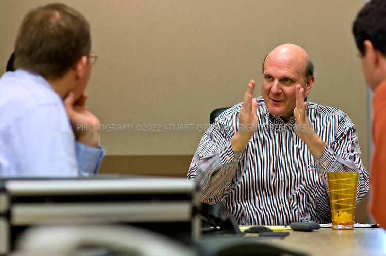 1/23/2006--Redmond, WA, USA..10:54am: Steve Ballmer, CEO of Microsoft, meeting in a 5th floor conference room with Pieter Knook (left), senior VP, Mobile and Embedded Devices Division & Communications sector and Todd Warren (hidden from view, left), Corporate VP, Mobile and Embedded Devices & Robert Bach (right), President, Entertainment and Devices Division. Ballmer was meeting with Microsoft's mobile device team to review product plans and the development, marketing and sales of software for devices such as mobile phones, personal digital assistants, portable media players, televisions and devices in cars...Photograph ©2007 Stuart Isett.All rights reserved