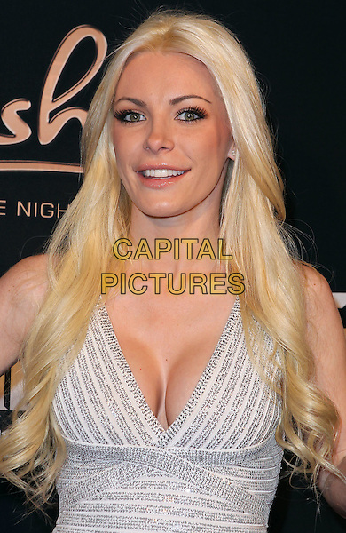 Crystal Harris .hosts at Posh Boutique Nightclub inside crazy Horse III,  Las Vegas, Nevada, USA, 16th March 2012..portrait headshot cleavage   beige silver white nude striped .CAP/ADM/MJT.© MJT/AdMedia/Capital Pictures.