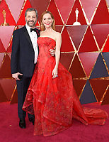 Judd Apatow, left, and Leslie Mann arrive at the Oscars on Sunday, March 4, 2018, at the Dolby Theatre in Los Angeles. (Photo by Richard Shotwell/Invision/AP)
