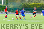 Tralee Dynamos Oliver Coffey clears his defence as James Dennehy of QPR closes him down, in the Greyhound Bar Cup Quarter final in Mounthawk Park on Sunday.