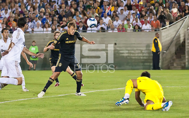 LOS ANGELES, CA – July 16, 2011: Adam Cristman (17) of the LA Galaxy heads his goal shot during the match between LA Galaxy and Real Madrid at the Los Angeles Memorial Coliseum in Los Angeles, California. Final score Real Madrid 4, LA Galaxy 1.