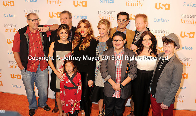WESTWOOD, CA- OCTOBER 28: (L-R) Actors Ed O'Neill, Ariel Winter, Eric Stonestreet, Aubrey Anderson-Emmons, Sofia Vergara, Rico Rodriguez, Julie Bowen, Ty Burrell, Sarah Hyland, Jesse Tyler Ferguson and Nolan Gould arrive at the 'Modern Family' Fan Appreciation Day at Westwood Village Theatre on October 28, 2013 in Westwood, California.