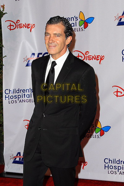 Antonio Banderas.Children's Hospital Los Angeles Gala: Noche de Ninos, Los Angeles, California, USA, 20th October 2012..half length black suit tie white shirt .CAP/ADM/PH.©Paul A. Hebert/AdMedia/Capital Pictures.