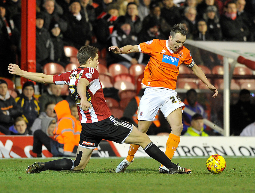Blackpool's Anthony McMahon holds off the challenge from Brentford's James Tarkowski  <br /> <br /> Photographer Ashley Western/CameraSport<br /> <br /> Football - The Football League Sky Bet League One - Brentford v Blackpool - Tuesday 24th February 2015 - Griffin Park - London<br /> <br /> &copy; CameraSport - 43 Linden Ave. Countesthorpe. Leicester. England. LE8 5PG - Tel: +44 (0) 116 277 4147 - admin@camerasport.com - www.camerasport.com
