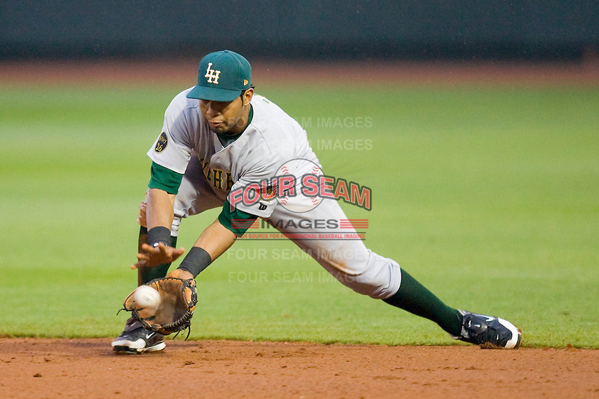 Second baseman Jose Gualdron #7 of the Lynchburg Hillcats fields a ground ball against the Winston-Salem Dash at  BB&T Ballpark May 22, 2010, in Winston-Salem, North Carolina.  Photo by Brian Westerholt / Four Seam Images