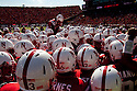 October 16, 2010: Nebraska Cornhuskers cornerback Marcus Mendoza #32 climbing up to fire up the Husker fans before they play Texas at Memorial Stadium in Lincoln, Nebraska. Texas defeated Nebraska 20 to 13.