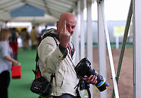 Monday 26 May 2014, Hay on Wye, UK<br /> Pictured: Photographer Keith Morris giving the finger<br /> Re: The Hay Festival, Hay on Wye, Powys, Wales UK.