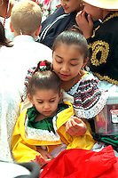 Sisters ages 4 and 9 at Cinco de Mayo festival.  St Paul Minnesota USA