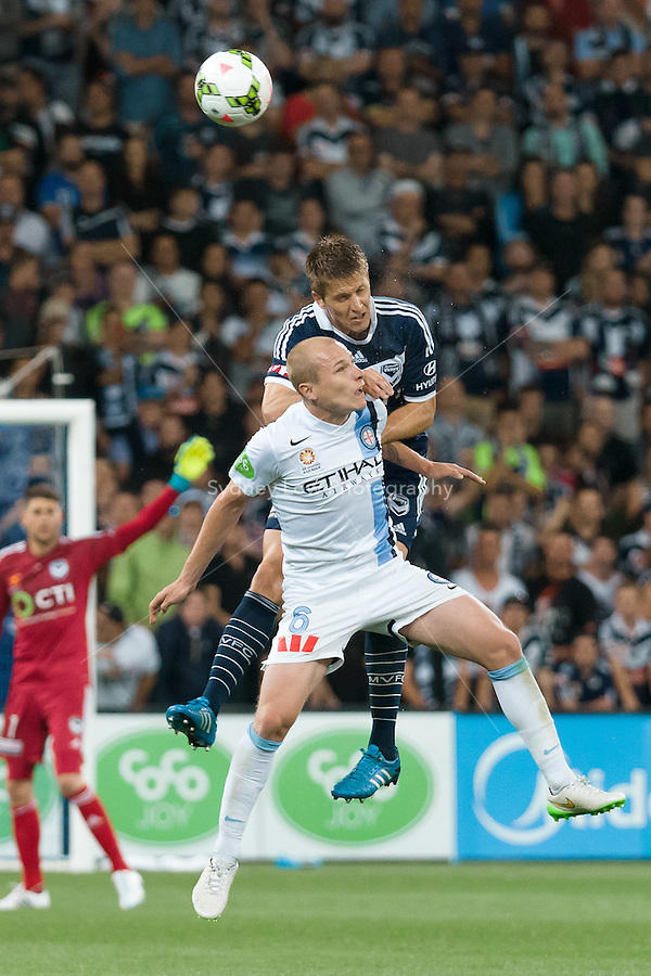 Adrian LEIJER of the Victory and Aaron MOOY of Melbourne City jump for the ball in round 11 A-League match between Melbourne City and Melbourne Victory at AAMI Park in Melbourne, Australia during the 2014/2015 Australian A-League season. City def Victory 1-0