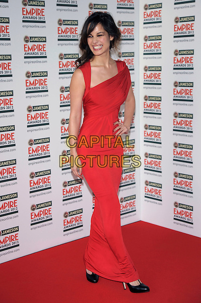 Berenice Marlohe.Jameson Empire Film Awards at the Grosvenor House Hotel, Park Lane, London, England, UK, .March 25th 2012.full length dress hand on hip smiling red long maxi  .CAP/PL.©Phil Loftus/Capital Pictures.