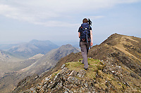 Female hiker near summit of Bla Bheinn Blaven, Black Cuillins, Isle of Skye, Scotland