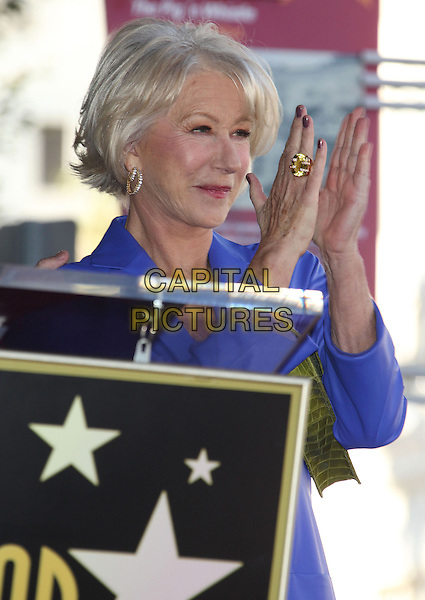 """Helen Mirren.""""Helen Mirren Honored With Star on The Hollywood Walk Of Fame held on Hollywood Boulevard in front of The Pig N' Whistle Pub, Hollywood, California, USA..January 3rd, 2012.half length purple jacket coat hands arms clapping ring blue .CAP/ADM/RE.©Russ Elliot/AdMedia/Capital Pictures."""