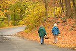 Two women walking with baskets in Hurd State Park. Mushroom searching.