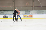 Joe Zieleniewski, left, and Frank Meyers, right, pretend to fight on the ice at Bird Arena during the 1960s hockey alumni reunion weekend on October 1, 2016.