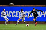 GREENSBORO, NC - DECEMBER 02: Samuel Ruiz Plaza #6 of Messiah College battles Henrik Roesholt #31 of North Park University during the Division III Men's Soccer Championship held at UNC Greensboro Soccer Stadium on December 2, 2017 in Greensboro, North Carolina. Messiah College defeated North Park University 2-1 to win the national title. (Photo by Grant Halverson/NCAA Photos via Getty Images)