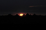 Sunrise over thatched huts in Kubum, a village in Sudan's conflict-torn Darfur region.