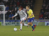 Jon Robertson tracks Liam Kelly in the St Mirren v Kilmarnock Clydesdale Bank Scottish Premier League match played at St Mirren Park, Paisley on 2.1.13.