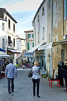 Street scene tourists shopping at St Martin de Re,  Ile de Re, France