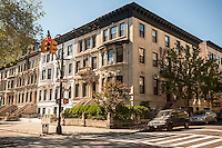 Attached row of townhouses on Convent Avenue in the Harlem neighborhood of New York on Sunday, October 12, 2014. (© Richard B. Levine)