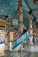 Ornate columns and spiral staircase inside the Cao Dai temple in Tay Ninh. Cao Dai (full name Dai Dao Tam Ky Pho Do), is the third largest religion in Vietnam, and this is its main temple, the Tay Ninh Holy See, in Tay Ninh, Vietnam