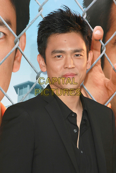 "JOHN CHO .""Harold and Kumar Escape From Guantanamo Bay"" Los Angeles Premiere held at the ArcLight Cinerama Dome Theatre, Hollywood, California, USA, 17 April 2008..portrait headshot black.CAP/ADM/`CH.©Charles Harris/Admedia/Capital PIctures"