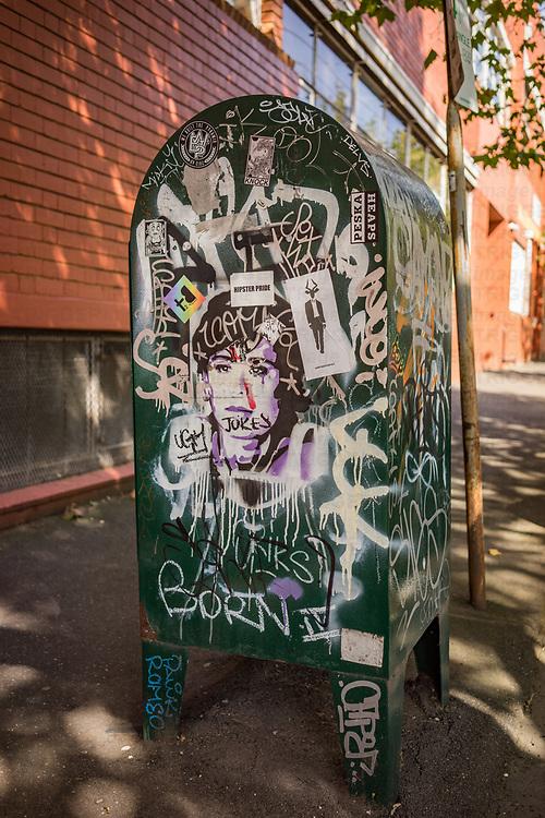 Murals and graffiti on dustbin in Melbourne Australia