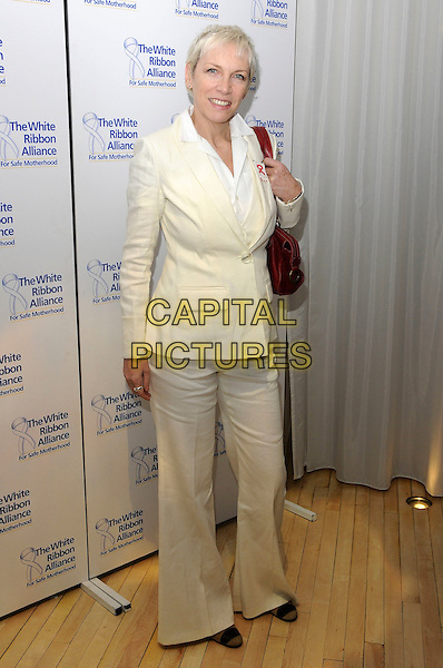 ANNIE LENNOX.The White Ribbon Alliance's Global Dinner Party Campaign, Agua, Sanderson Hotel, London, England. .March 4, 2010 .full length white cream jacket trousers suit beige.CAP/CAS.©Bob Cass/Capital Pictures.