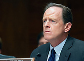 """United States Senator Pat Toomey (Republican of Pennsylvania) listens as Randal K. Quarles, Vice Chairman for Supervision, Board of Governors of the Federal Reserve System, testifies before the US Senate Committee on Banking, Housing, and Urban Affairs on Capitol Hill in Washington, DC on """"The Semiannual Testimony on the Federal Reserve's Supervision and Regulation of the Financial System"""" on Thursday, April 19, 2018.<br /> Credit: Ron Sachs / CNP"""