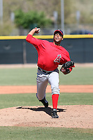 Manaurys Correa #4 of the Los Angeles Angels plays in a minor league spring training game against the Colorado Rockies at the Angels minor league complex on March 23, 2011  in Tempe, Arizona. .Photo by:  Bill Mitchell/Four Seam Images.