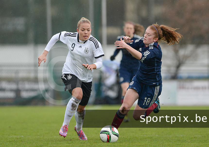 20150404 - FORST , GERMANY  : German Nina Ehegotz (left) pictured in action with Scottish Megan Karagiozis (right) behind her  during the soccer match between Women Under 19 teams of Germany and Scotland , on the first matchday in group 5 of the UEFA Elite Round Women Under 19 at WaldseeStadion , Forst , Germany . Saturday 4th April 2015 . PHOTO DAVID CATRY