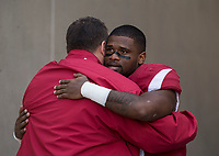 Hawgs Illustrated/BEN GOFF <br /> Bret Bielema, Arkansas head coach, hugs running back David Williams during recognition of senior players before the game against Missouri Friday, Nov. 24, 2017, at Reynolds Razorback Stadium in Fayetteville.