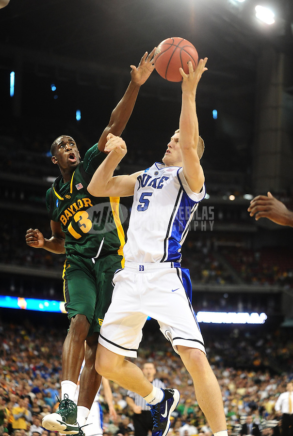 Mar. 28, 2010; Houston, TX, USA; Duke Blue Devils forward (5) Mason Plumlee is defended by Baylor Bears forward (13) Ekpe Udoh during the finals of the south regional in the 2010 NCAA mens basketball tournament at Reliant Stadium.  Duke defeated Baylor 78-71. Mandatory Credit: Mark J. Rebilas-