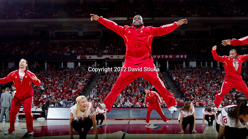 Wisconsin Badgers dance team performs with members of the football team, including Montee Ball, center, during a Big Ten Conference NCAA college basketball game against the Penn State Nittany Lions on Sunday, February 19, 2012 in Madison, Wisconsin. The Badgers won 65-55. (Photo by David Stluka)