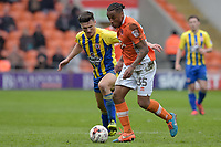Blackpool's Neil Danns under pressure from  Accrington Stanley's Matty Pearson<br /> <br /> Photographer Terry Donnelly/CameraSport<br /> <br /> The EFL Sky Bet League Two - Blackpool v Accrington Stanley - Friday 14th April 2017 - Bloomfield Road - Blackpool<br /> <br /> World Copyright &copy; 2017 CameraSport. All rights reserved. 43 Linden Ave. Countesthorpe. Leicester. England. LE8 5PG - Tel: +44 (0) 116 277 4147 - admin@camerasport.com - www.camerasport.com