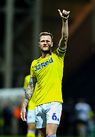 Leeds United's Liam Cooper salutes the fans after the match<br /> <br /> Photographer Alex Dodd/CameraSport<br /> <br /> The EFL Sky Bet Championship - Preston North End v Leeds United -Tuesday 9th April 2019 - Deepdale Stadium - Preston<br /> <br /> World Copyright &copy; 2019 CameraSport. All rights reserved. 43 Linden Ave. Countesthorpe. Leicester. England. LE8 5PG - Tel: +44 (0) 116 277 4147 - admin@camerasport.com - www.camerasport.com
