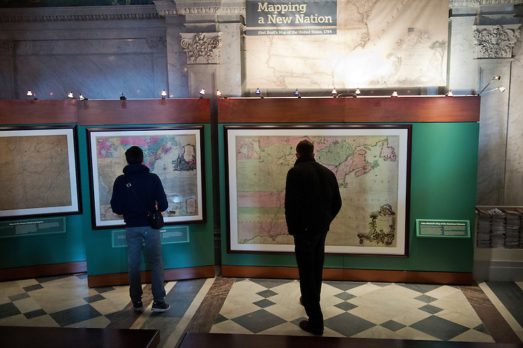 UNITED STATES - JANUARY 06: Visitors to the Library of Congress Thomas Jefferson Building view 18th century maps of the United States. (Photo By Tom Williams/CQ Roll Call)