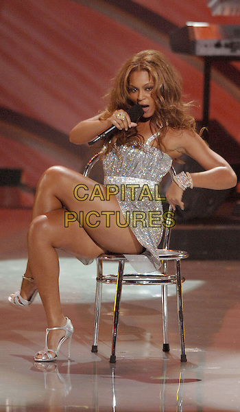 BEYONCE KNOWLES (DESTINY'S CHILD).Perform at The World Music Awards-Show held at the Kodak Theatre,.Hollywood, 31st  August 2005.full length stage gig concert silver sequin sparkly dress microphone singing dancing chair.www.capitalpictures.com.sales@capitalpictures.com.© Capital Pictures.