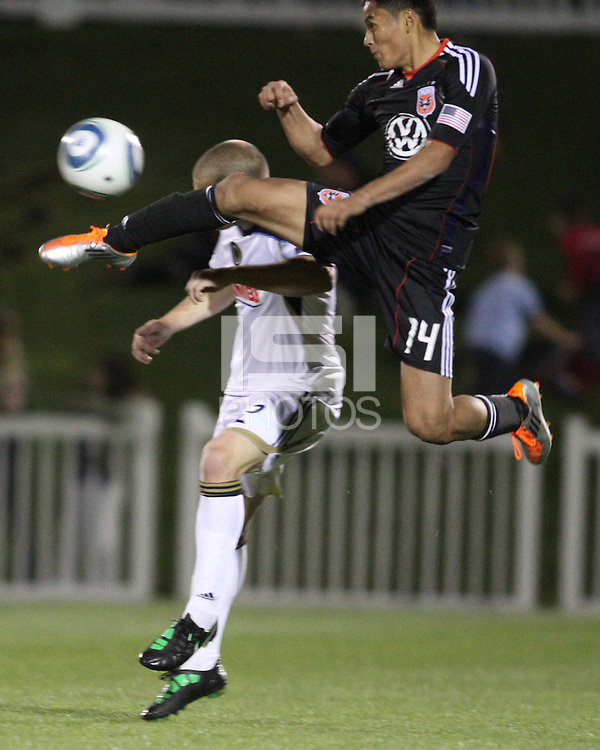 Andy Najar(14) of D.C. United leaps high to get the ball from Jordan Harvey(2) of the Philadelphia Union during a play-in game for the US Open Cup tournament at Maryland Sportsplex, in Boyds, Maryland on April 6 2011. D.C. United won 3-2 after overtime penalty kicks.